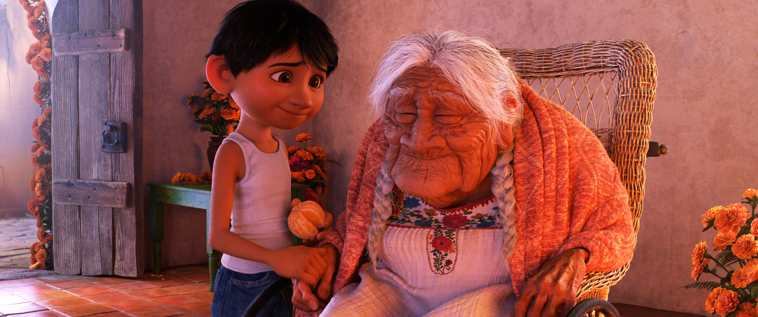"""COCO (Pictured) - FAMILY BONDS - In Disney•Pixar's""""Coco,"""" Miguel (voice of Anthony Gonzalez) has a very special relationship with his great-great-grandmother, Mamá Coco (voice of Ana Ofelia Murguía). Directed by Lee Unkrich and co-directed by Adrian Molina, Disney•Pixar's""""Coco,"""" opens in U.S. theaters on Nov. 22, 2017. ©2017 Disney•Pixar. All Rights Reserved."""