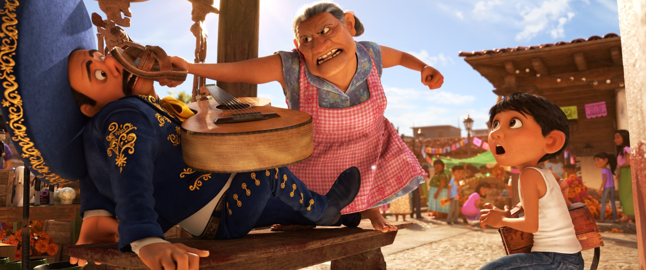 """NO MUSIC – In Disney•Pixar's""""Coco,"""" which opens in U.S. theaters on Nov. 22, 2017, aspiring musician Miguel challenges his family's generations-old ban on music, spending time with a local mariachi. But his grandmother Abuelita promptly puts a stop to it. """"Coco"""" features Lombardo Boyar as the voice of the mariachi, Renée Victor as the voice of Abuelita and Anthony Gonzelez as the voice of Miguel. ©2017 Disney•Pixar. All Rights Reserved."""