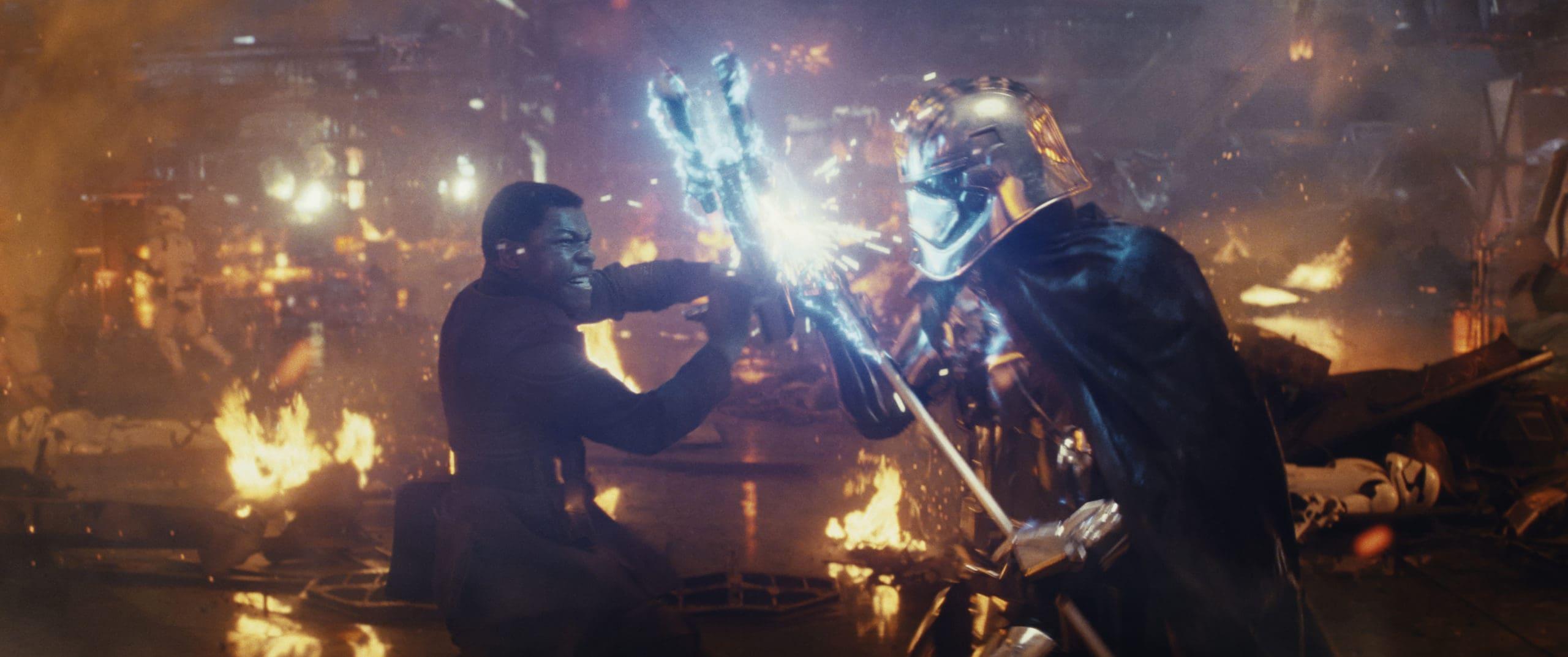 Star Wars: The Last Jedi..L to R: Finn (John Boyega) battling Captain Phasma (Gwendoline Christie)..Photo: Lucasfilm Ltd. ..© 2017 Lucasfilm Ltd. All Rights Reserved.