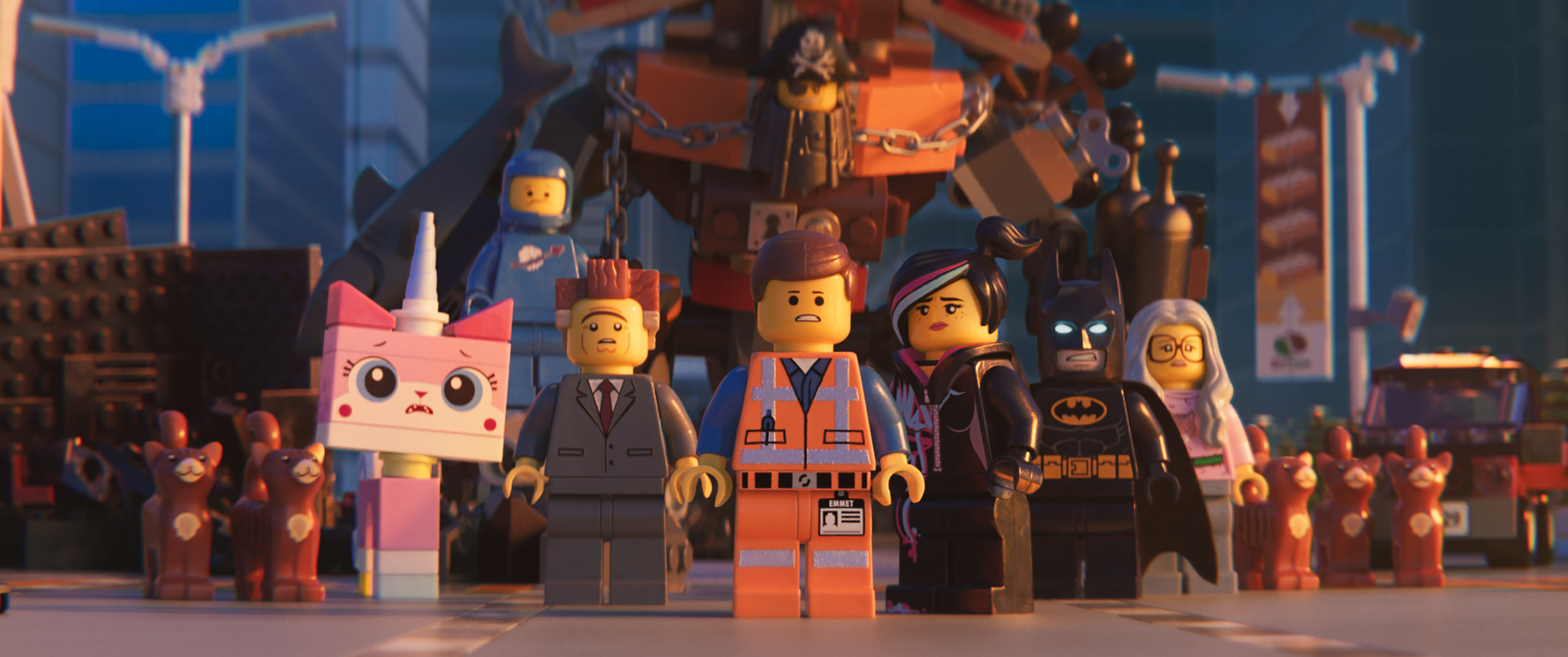 """(L-R) Unikitty (ALISON BRIE), Benny (CHARLIE DAY), President Business (WILL FERRELL), MetalBeard (NICK OFFERMAN), Emmet (CHRIS PRATT), Lucy/Wyldstyle (ELIZABETH BANKS) and Batman (WILL ARNETT) in a scene from the animated adventure """"The LEGO® Movie 2: The Second Part,"""" from Warner Bros. Pictures and Warner Animation Group, in association with LEGO System A/S, a Warner Bros. Pictures release."""