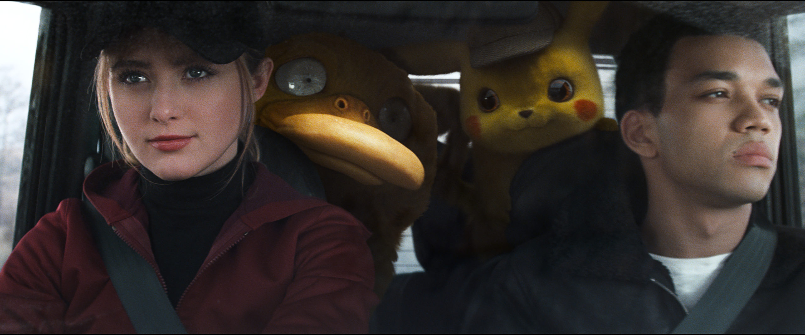 "(L-R) KATRHYN NEWTON as Lucy Stevens, Psyduck, Detective Pikachu (RYAN REYNOLDS) and JUSTICE SMITH as Tim Goodman in Legendary Pictures' and Warner Bros. Pictures' comedy adventure ""POKÉMON DETECTIVE PIKACHU,"" a Warner Bros. Pictures release."